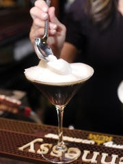 A server prepares The Wide Awake Drunk Martini, available