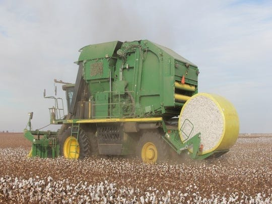 A cotton baler works on a farm in northern Reagan County. Yields, thanks to good rainfall, were above average in 2016.