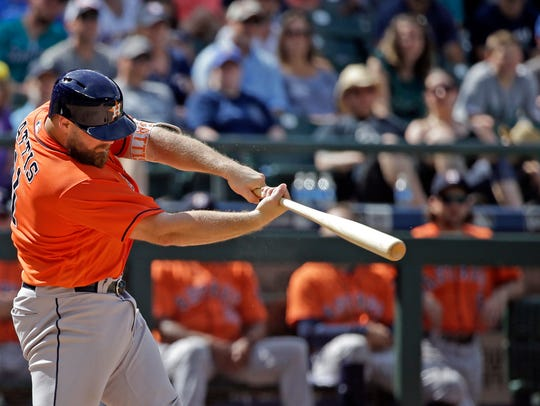 Houston Astros' Evan Gattis belts a two-run home run