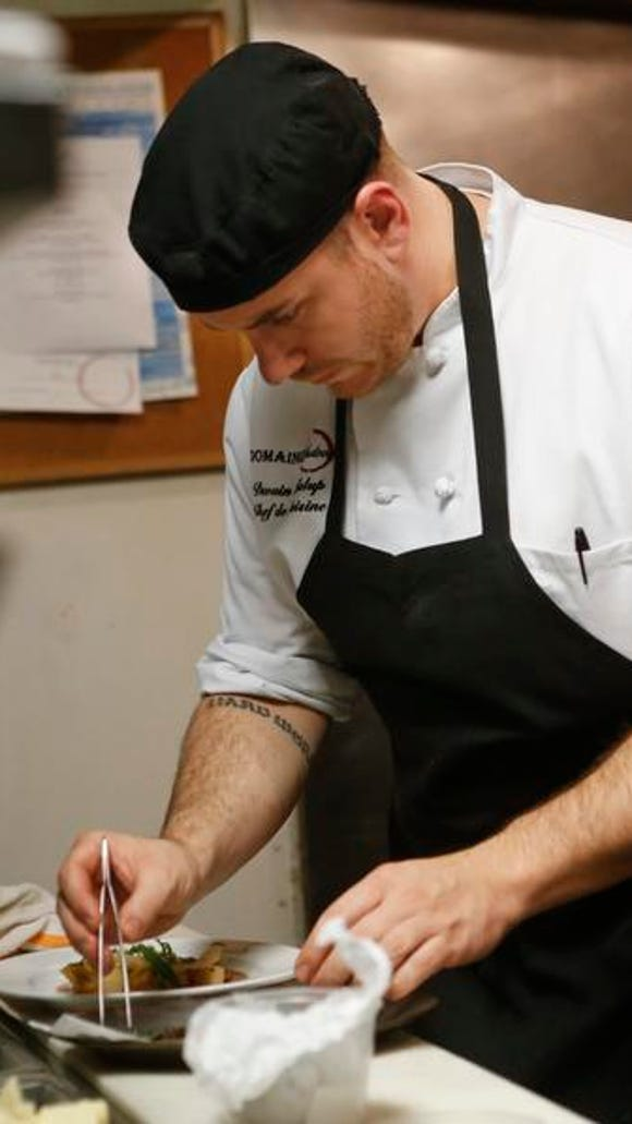 Executive chef Dwain Kalup in the kitchen at Domaine Hudson in Wilmington,