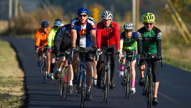 Bicyclists including Scott Vogeler, left, Harvey Liberman, Barbara Baum and Roger Fouts ride on Old Walland Highway on  Oct. 13, 2016, in Blount County. The two-lane road that starts behind Heritage High School in Maryville gives East Tennessee's legion of bicycling enthusiasts one beautiful way to reach the Smoky Mountains.