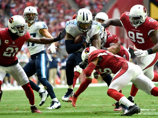 Titans running back Derrick Henry (22) rushes for eight
