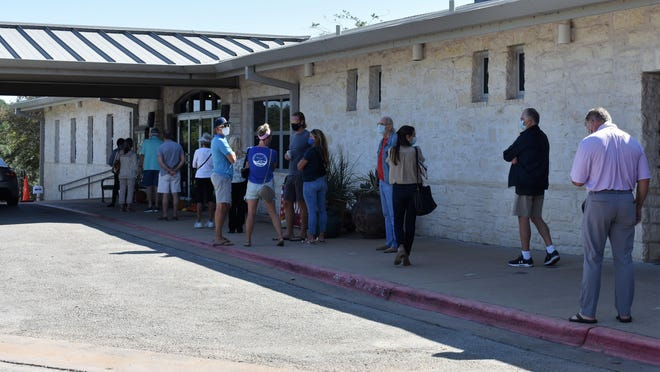 Voters wait to cast their ballots at the Lakeway Activity Center.