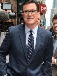 """Television personality Stephen Colbert enters the """"Late Show With David Letterman"""" taping at the Ed Sullivan Theater on April 22, 2014 in New York City."""