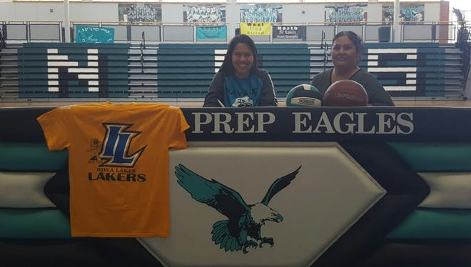 Jazmin Benally, left, signs a letter of intent to play basketball and volleyball at Iowa Lakes Community College on Wednesday at Navajo Prep.
