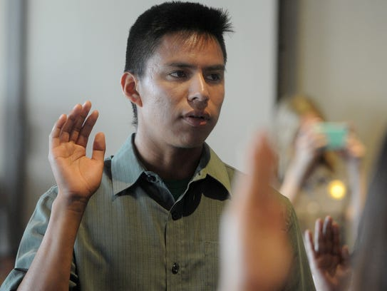 Fernando Alfaro, of Ventura, takes an oath during a