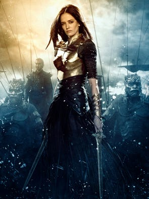 Artemisia (Eva Green) dresses the part of warrior in a bronze breastplate, mesh sleeves and bronze cuffs. She's girded for battle with leather strips and skirting in '300: Rise of an Empire.'