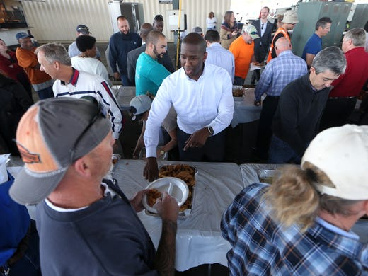 Tallahassee Mayor Andrew Gillum give t take a deep-fried fish