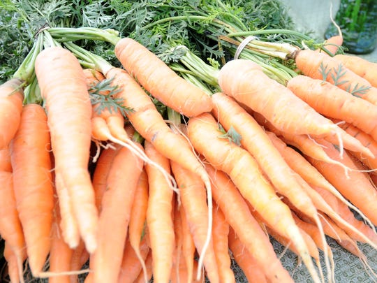 Carrots at a farmers market in 2011. Daily Herald Media file photo.