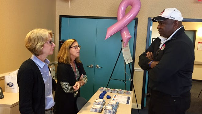 Former New York Giant George Martin discusses breast cancer screening and awareness initiatives with employees at Port Chester's Open Door Family Medical Center for A Crucial Catch Day on Oct. 25, 2016.