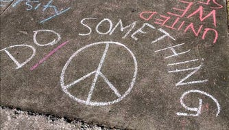 Sidewalk messages written by Plant High School seniors, Tampa, Fla., Feb. 16, 2018.