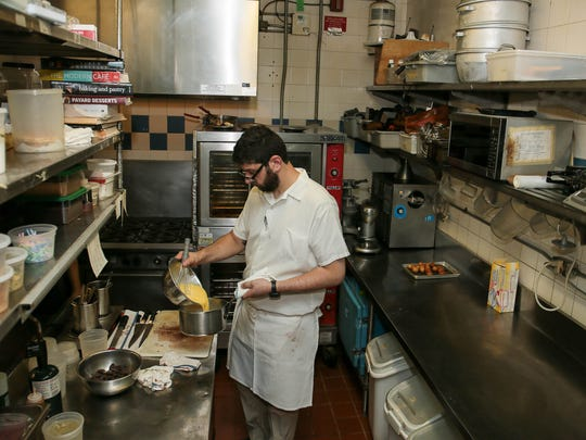 Pastry Chef Ben Deutsch at work at The Frog and The Peach in New Brunswick on July 26, 2016.