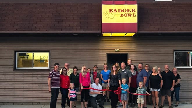 The new owners of Mishicot's Badger Bowl celebrate a ribbon-cutting ceremony. From left: Jay Stoeger, Kay Stoeger, George Krause, Sally Kintgen, Emma Baugniet, Heather Baugniet, Cheryl Baugniet, Michael Baugniet, Jeff Baugniet, Christine Bressler, Andrea Novak, Jeff Novak, Angie Hoeffner, Bryce Novak, Samantha Shedlosky, Kevin Shedlosky, Tammy Schmidt, Allison Honzik, Sandy Honzik, Lowicke Shedlosky and Nolan Baugniet.