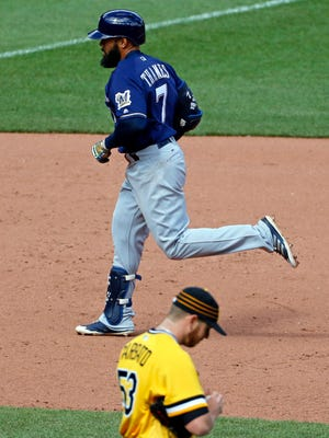 Eric Thames rounds the bases after hitting a solo home run off Pittsburgh Pirates relief pitcher Johnny Barbato in the ninth inning.