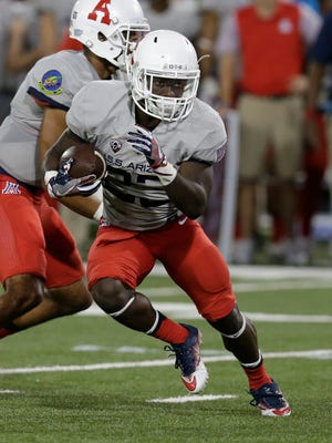 Arizona running back J.J. Taylor (23) during the first half of an NCAA college football game against Hawaii, Saturday, Sept. 17, 2016, in Tucson, Ariz.