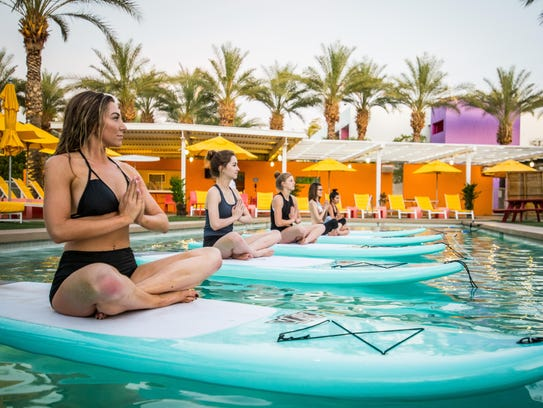Paddleboard yoga is offered at the Saguaro Scottsdale