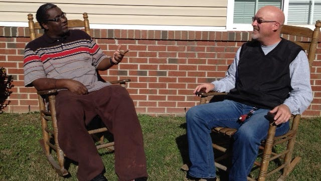 Kirk Johnson, right, Nashville Prevention Partnership peer recovery coordinator, talks with Metro inmate Sharn Green.