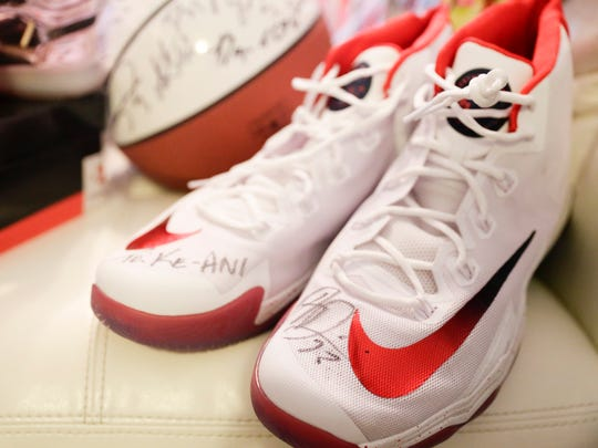 Autographed shoes from the New Orleans Pelicans are among the gifts Ke'ani and Shania Page received after a wishlist to Santa Claus on a balloon was found, in Lafayette Monday, Jan. 9, 2016.