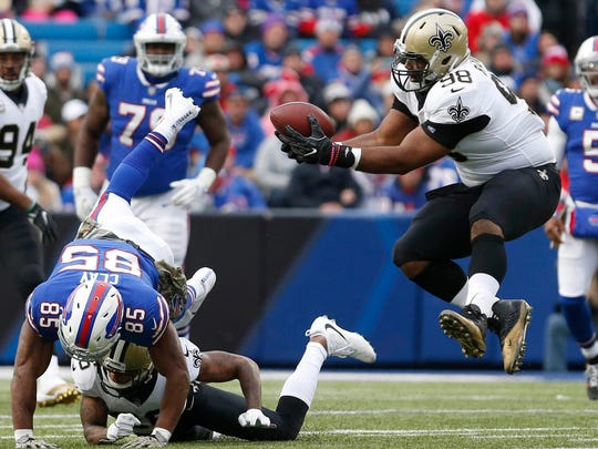 New Orleans Saints defensive tackle Sheldon Rankins intercepts the ball during the second half against the Buffalo Bills at New Era Field.