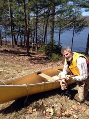 Glenn Adams takes a break on the shores of Pleasant Pond in Richmond, Maine, which flows into the Kennebec River. Adams canoed, kayaked and motorboated the Kennebec in segments.