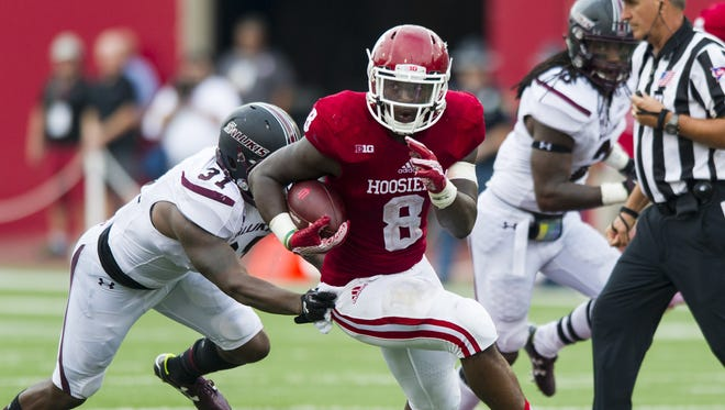 Indiana Hoosiers running back Jordan Howard (8) runs the ball upfield as he's pursued by Southern Illinois Salukis safety Kenny James (31) during second-half action of a NCAA football game, Saturday, September 5, 2015, in Bloomington. Indiana won the game 48-47.