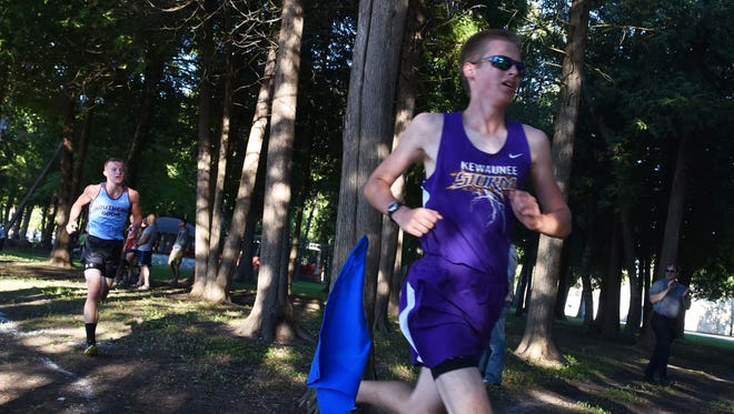 Jacob Czech of Kewaunee runs the course at Bruemmer Park in the Kewaunee Cross Country Invitational Meet on  Sept. 21. Close behind is Jacob Pigeon of Southern Door.