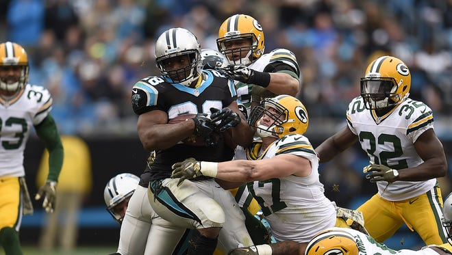Green Bay Packers linebacker Jake Ryan (47) tackles Carolina Panthers running back Jonathan Stewart (28) during Sunday's game at Bank of America Stadium in Charlotte, N.C.