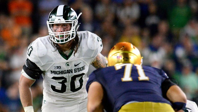 Michigan State University senior linebacker Riley Bullough (30) watches the Irish offense in the second half of the Spartans game against Notre Dame Saturday, Sept. 17, 2016 in South Bend, Ind.