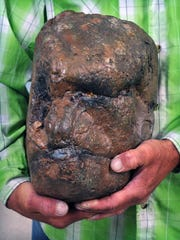 Todd May holds a rock-like object that he believes is a petrified fossil of the head of a Sasquatch, also known as Bigfoot. May was hunting for fossils in Ogden Canyon of Ogden, Utah when he saw the head-shaped specimen. May also says he has spotted Bigfoot on two occasions so he knows what Bigfoot's head is shaped like.