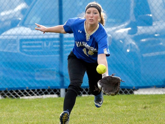 Webster Schroeder's Jessica Randise tracks a ball hit