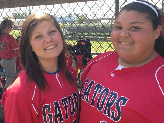 Sophomore catcher Bailey Holston (left) and senior second baseman/designated hitter Alaina Smith were heavy lifters among volunteers who helped revive Northwood High School's old softball field.