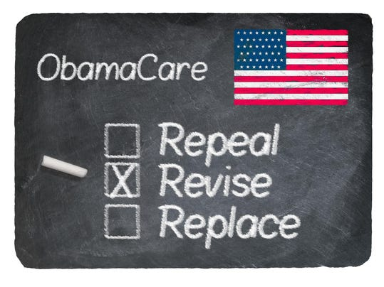 Obamacare concept using chalk on slate blackboard
