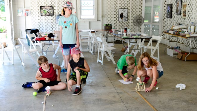 Kids build catapults to launch tennis balls and marshmallows during Summer Science Camp for middle school students. The four-day session at Schedel Arboretum and Gardens in Elmore ended with a class on Friday afternoon. Another four-day camp for students entering grades 6, 7 or 8 is scheduled for July 17-20.