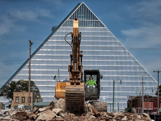 Demolition crews remove several buildings across South Third from the main campus of St. Jude Children's Research Hospital in June to create a clean canvas for part of its $1 billion plan for capital improvements.