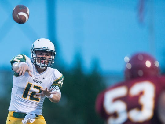 Edgewood Academy's Nathan Rourke throws a pass during