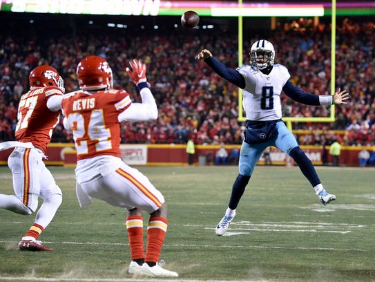 Titans quarterback Marcus Mariota (8) passes on a play that was deflected and ultimately caught by Mariota, leading to his touchdown during the second half at Arrowhead Stadium on Jan. 6.