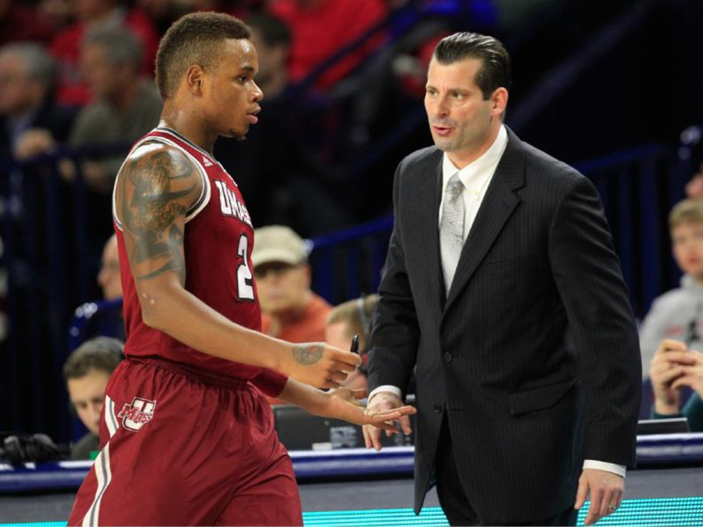 UMass coach Derek Kellogg, right, helped Derrick Gordon come out to his Minutemen teammates before transferring to Seton Hall.