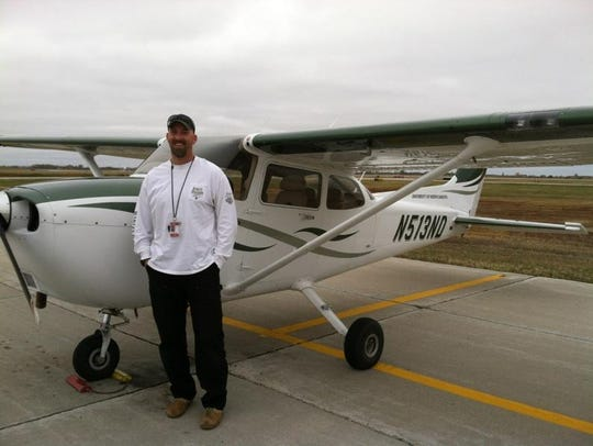Michael Sticka poses after his first solo flight at