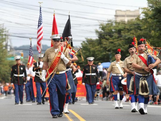 Drum Major with the Leathernecks Pipes and Drums, Glenn Sheehan, takes part in the annual John Basilone Parade held in downtown Raritan in 2014. The parade returns Sept. 24 to downtown Raritan Borough.