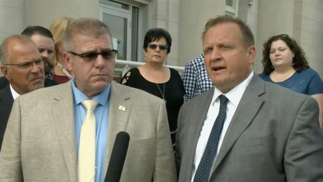 Rep. Darren Bailey (left), R-Xenia, and his attorney, Thomas DeVore, speak to reporters outside the Clay County Courthouse in Louisville in a file photo from earlier this year.