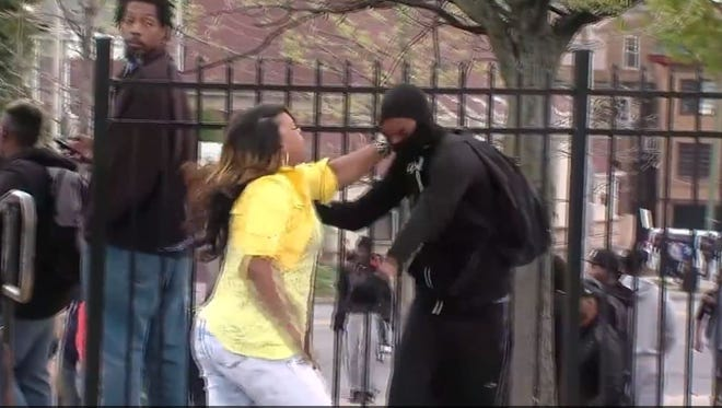 A Baltimore mother found her son among the rioters, and snatched him out of the crowd.