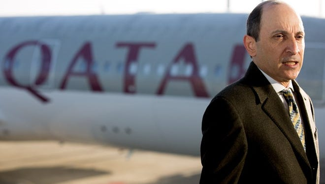 Qatar Airways' first Airbus A350 is seen in the background as Akbar Al Baker, the airline's CEO, speaks during a delivery ceremony for the aircraft in Toulouse, France, on Dec. 22, 2014.