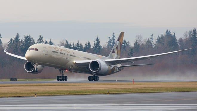 Etihad's first Boeing 787-9 Dreamliner departs Everett, Wash., for Abu Dhabi, United Arab Emirates, on Saturday, Jan. 3, 2015.