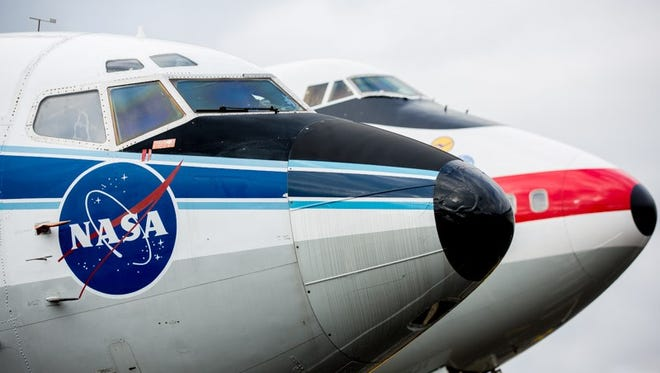 The nose of the first Boeing 747 looms behind the nose of its smaller and slightly older sibling, the first Boeing 737, at the Museum of Flight in Seattle on February 14, 2015.