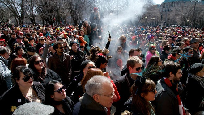 "Thousands came to Midtown for the sixth annual Marche du Nain Rouge in Detroit on March 22, 2015. The march celebrates the beginning of spring and to banish the ""Nain Rouge"" and save the city from its woes."