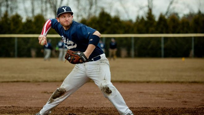 Yale senior Jacob Ramsey fires the ball to first base from second during baseball practice Thursday, March 26, 2015 at Yale High School.