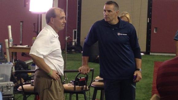 Jimbo Fisher and former NFL QB Kurt Warner of the NFL