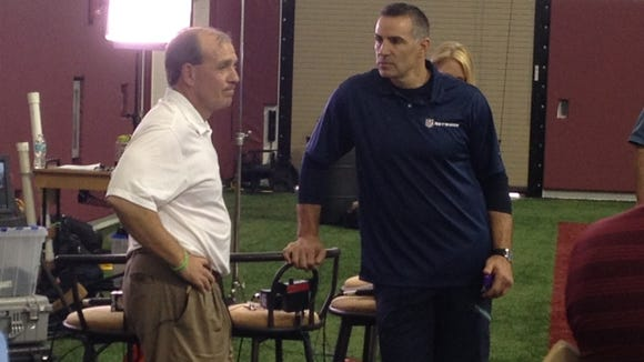 Jimbo Fisher and former NFL QB Kurt Warner of the NFL