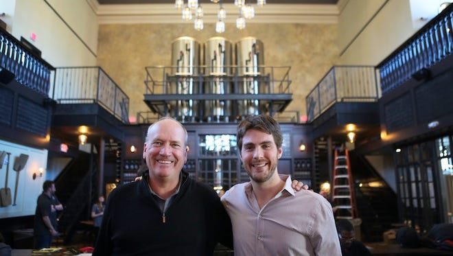 Taft's Ale House managing partners Dave Williams and Dave Kassling, pose for a portrait inside Taft's Ale House Wednesday, April 1, 2015 at Race and 15th. Doors will open at 8:30 a.m. Monday, April 6, 2015, The Enquirer/Meg Vogel