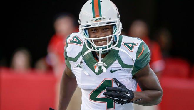 Miami wide receiver Phillip Dorsett (4) smiles before an NCAA college football game against Nebraska in Lincoln, Neb., Saturday, Sept. 20, 2014. (AP Photo/Nati Harnik)